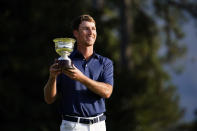 Andy Ogletree poses with his low amateur trophy following the Masters golf tournament Sunday, Nov. 15, 2020, in Augusta, Ga. (AP Photo/Matt Slocum)