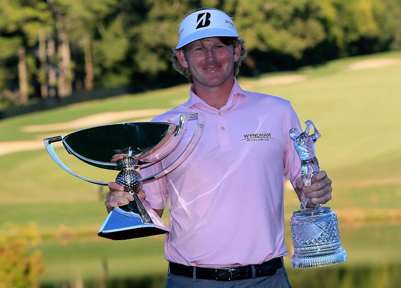 ATLANTA, GA - SEPTEMBER 23:  Brandt Snedeker poses with the FedExCup and TOUR Championship trophies after his three stroke victory clinched the FedExCup during the final round of the TOUR Championship by Coca-Cola at East Lake Golf Club on September 23, 2012 in Atlanta, Georgia.  (Photo by Sam Greenwood/Getty Images)