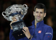 FILE - In this Jan. 31, 2016, file photo, Novak Djokovic, of Serbia, holds his trophy aloft after defeating Andy Murray, of Britain, in the men's singles final at the Australian Open tennis championships in Melbourne, Australia. If Djokovic wins Wimbleon and the U.S. Open to complete a true Grand Slam, he will have a fan in the last man to do it. Rod Laver knows what it takes to complete tennis' ultimate achievement, having won the Grand Slam as an amateur in 1962 and again as a pro in 1969. Since then, no man has come close. (AP Photo/Aaron Favila, File)