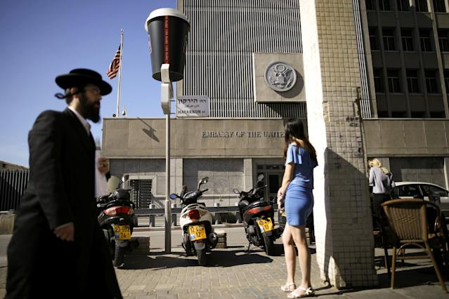 An ultra-Orthodox Jewish man walks by the U.S. Embassy in Tel Aviv. (Photo: Amir Cohen/Reuters)