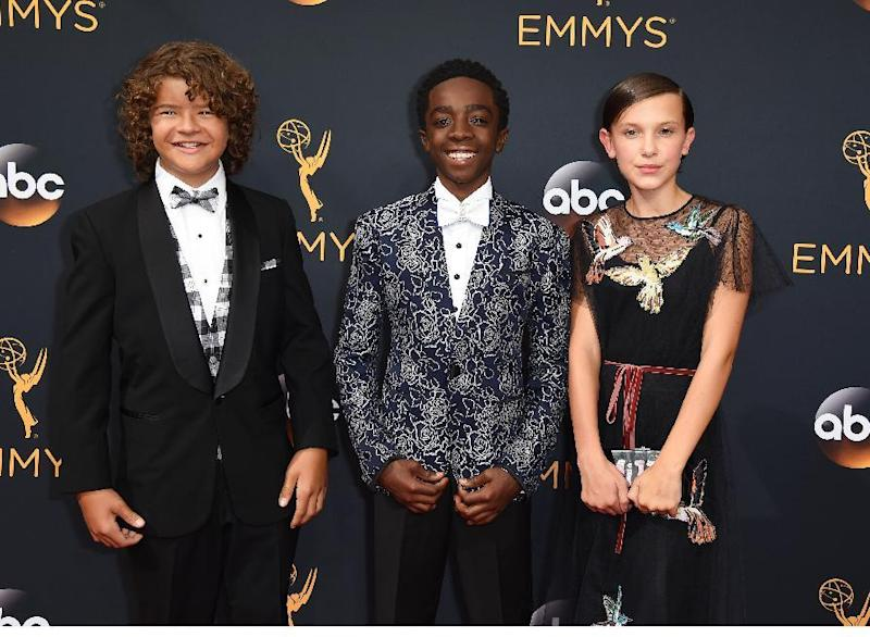 Gaten Matarazzo, from left, Caleb McLaughlin, and Millie Bobby Brown arrive at the 68th Primetime Emmy Awards on Sunday, Sept. 18, 2016, at the Microsoft Theater in Los Angeles. (Photo by Jordan Strauss/Invision/AP)