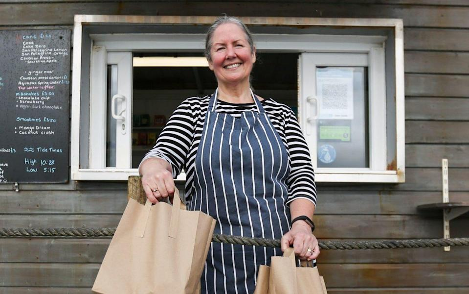 Fiona Crump, owner of the Castle Beach Cafe in Falmouth. she will be making free lunch bags during half term for any child who will normally get a free school lunch - Cameron Smith/PA