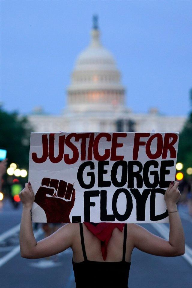 Demonstrators walk along Pennsylvania Avenue as they protest the death of George Floyd