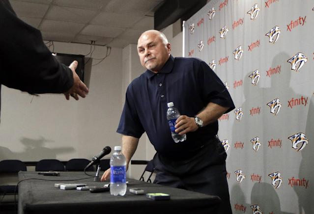 FILE - In this April 14, 2014, file photo, Nashville Predators coach Barry Trotz leaves a news conference in Nashville, Tenn. The Washington Capitals have promoted Brian MacLellan to general manager and hired former Predators coach Trotz. The team announced the moves Monday, May 26, 2014. (AP Photo/Mark Humphrey, File)