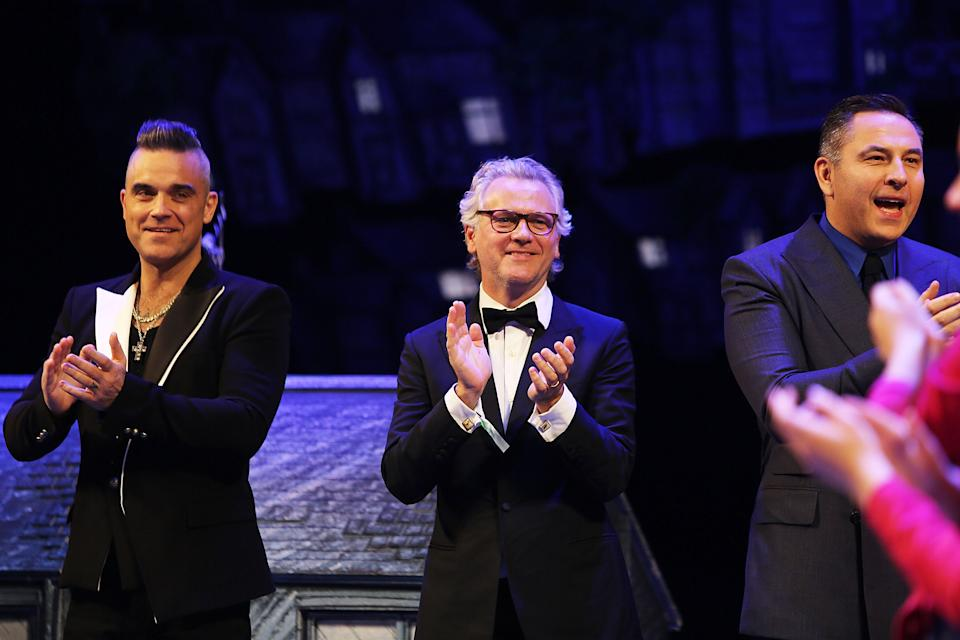 "STRATFORD-UPON-AVON, ENGLAND - NOVEMBER 28:  (L-R) Robbie Williams, Guy Chambers and David Walliams attend the press night performance of ""The Boy In The Dress"" at Royal Shakespeare Theatre on November 28, 2019 in Stratford-upon-Avon, England.  (Photo by David M. Benett/Dave Benett/Getty Images)"
