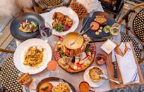 "<p>Chefs Andrew Carmellini and Brian Nasworthy, along with partners Luke Ostrom and Josh Pickard, have created <a href=""https://www.lafayetteny.com/"" rel=""nofollow noopener"" target=""_blank"" data-ylk=""slk:Le Village de Lafayette"" class=""link rapid-noclick-resp"">Le Village de Lafayette</a>, a festive winter-wonderland pop-up of individual chalets featuring a hearty menu that highlights the restaurant's signature French brasserie offerings. </p><p>The private heated chalets, which are fully disinfected after each use, are steel frame structures with clear polycarbonate window panels created to provide maximum cozy comfort. Ostrom, who spearheaded the design, wanted to ""create a winter pop up experience reminiscent of chalets in the French Alps.'' ""Playing off the natural daylight and the evening glow from city lights that the transparent structures enjoy, I leaned towards neutral tones and white, and silver blues,"" he says. ""We used natural alpaca furs, handwoven mini-carpets, kiln-dried split fire wood, and dehydrated pampas grasses to keep a chic apres ski vibe."" Subtle icicles and snowflakes on the roof reference the season and create a charming street scene that glows in the Gotham night.</p><p>Menu highlights include a decadent fondue made with a blend of Comte, Gruyère, Swiss, Emmenthal, and freshly grated black winter truffle, and served with heaps of pain de campagne, endive, cornichon, potato, apple, and rosette de Lyon, and expertly prepared classics like escargots Lyonnaise, chicken Provençale, and an impossibly light mousse au chocolat.</p>"