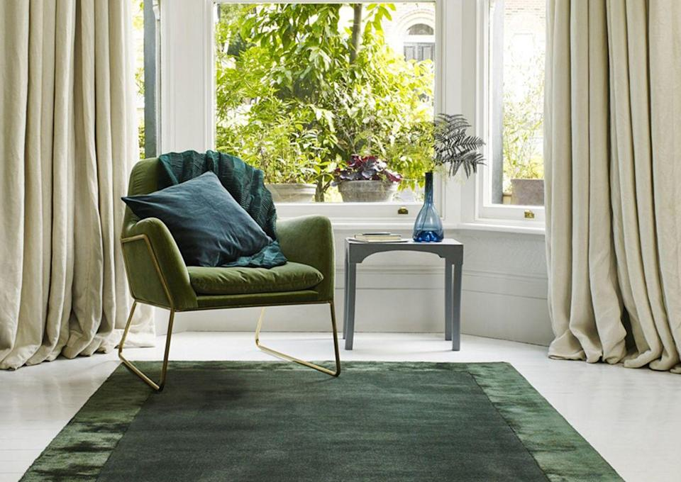 """<p>Since working from home became the new normal for so many of us, it has never been more important to separate areas of your home for different activities. </p><p>If you have the space, a rug is the ideal way to define a workspace, dressing area or even relaxing reading corner from the rest of your bedroom. </p><p>A rich rug like this choice from The Rug Seller also floods a space with green without the need for re-carpeting.</p><p><strong>The Rug Seller Ascot Plain Modern Bordered Wool Rug in Green, <a href=""""https://go.redirectingat.com?id=127X1599956&url=https%3A%2F%2Fwww.therugseller.co.uk%2Fascot-rugs-in-green%2Fp-30-1027-5381-6&sref=https%3A%2F%2Fwww.goodhousekeeping.com%2Fuk%2Fhouse-and-home%2Fhome-decorating-ideas%2Fg36449164%2Fgreen-bedroom-ideas%2F"""" rel=""""nofollow noopener"""" target=""""_blank"""" data-ylk=""""slk:from £139."""" class=""""link rapid-noclick-resp"""">from £139.</a> </strong></p>"""