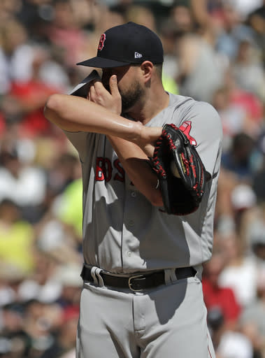Boston Red Sox starting pitcher Brian Johnson wipes his face during the first inning of a baseball game against the Chicago White Sox, Sunday, Sept. 2, 2018, in Chicago. (AP Photo/Nam Y. Huh)