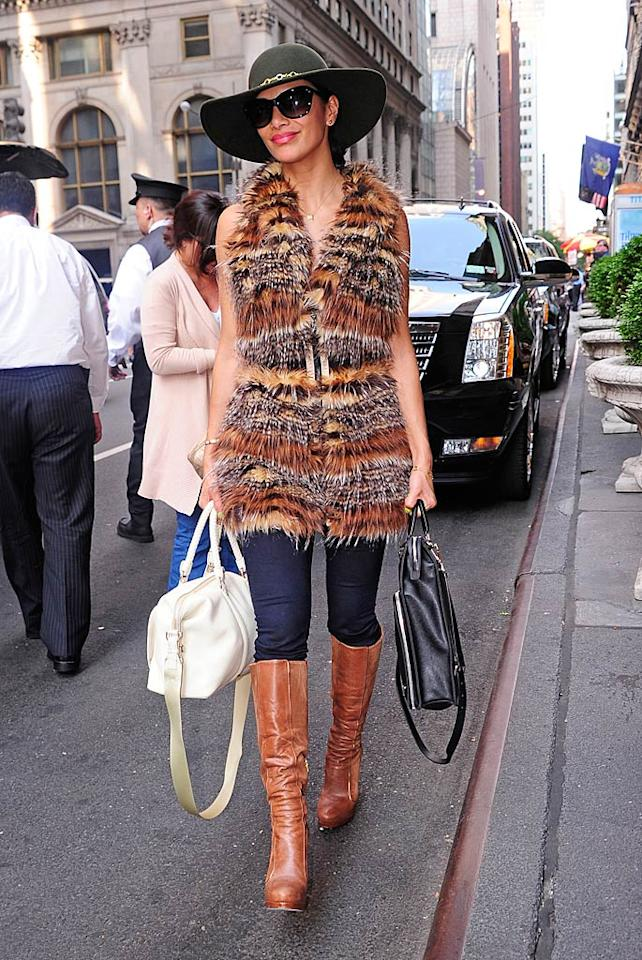 """Pussycat Doll Nicole Scherzinger also loves hats that scream, """"Look at me!"""" Clearly, she also loves coats that scream, """"Look, I just skinned a Muppet!"""" <a href=""""http://www.splashnewsonline.com"""" target=""""new"""">Splash News</a> - June 7, 2011"""