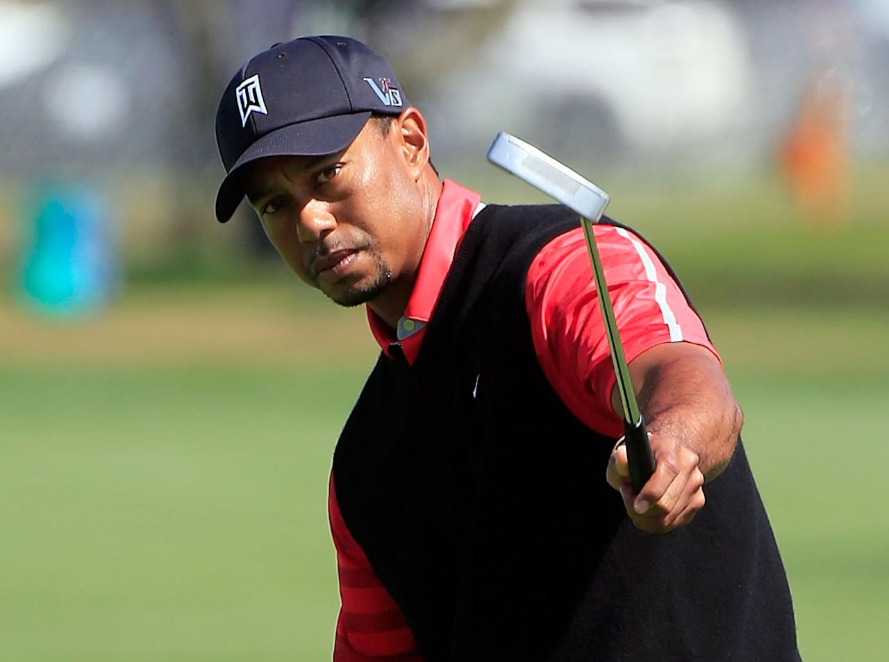 ORLANDO, FL - MARCH 25:  Tiger Woods reacts to a birdie attempt on the 9th hole during the final round of the Arnold Palmer Invitational presented by MasterCard at the Bay Hill Club and Lodge on March 25, 2013 in Orlando, Florida.  (Photo by Sam Greenwood/Getty Images)