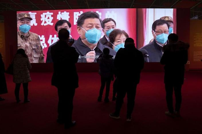 Residents attend an exhibition on the city's fight against the coronavirus in Wuhan in central China's Hubei province on Saturday, Jan. 23, 2021. A year after it was locked down to contain the spread of coronavirus, the central Chinese city of Wuhan has largely returned to normal, even as China continues to battle outbreaks elsewhere in the country. (AP Photo/Ng Han Guan)