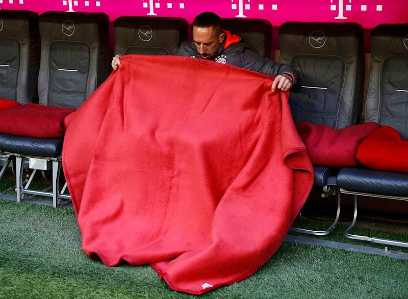 Football Soccer - Bayern Munich v Eintracht Frankfurt - German Bundesliga - Allianz Arena, Munich, Germany - 11/03/17 - Bayern Munich's Franck Ribery adjusts his blanket before the match. REUTERS/Wolfgang Rattay DFL RULES TO LIMIT THE ONLINE USAGE DURING MATCH TIME TO 15 PICTURES PER GAME. IMAGE SEQUENCES TO SIMULATE VIDEO IS NOT ALLOWED AT ANY TIME. FOR FURTHER QUERIES PLEASE CONTACT DFL DIRECTLY AT + 49 69 650050 - Credit: WOLFGANG RATTAY/REUTERS