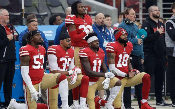 PHOTO: San Francisco 49ers' Eli Harold, Eric Reid, Marquise Goodwin and Louis Murphy kneel during the national anthem before an NFL football game against the Jacksonville Jaguars in Santa Clara, Calif., Dec. 24, 2017. (Marcio Jose Sanchez/AP, FILE)