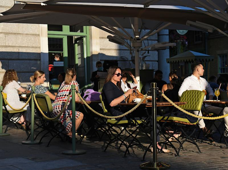 People sit outside at a restaurant in Covent Garden, London, 21 September 2020. (Kirsty O'Connor/PA)