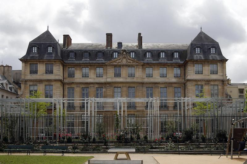 """In this photo taken on Monday, May 12, 2014, a view of the closed Pablo Picasso museum in Paris. Paris proudly hosted Picasso for decades. But two controversies around the artist's legacy are now haunting French officials. One centers on the Paris Picasso Museum, where renovations have dragged for five years amid accusations of mismanagement, labor problems and clashes between the artist's family and the French government. The re-opening has now been pushed back until September _ after the summer tourist season. The other is about the fate of a Left Bank studio where Picasso lived and worked for 19 years, and painted his famed anti-war opus """"Guernica"""" in 1937. A historic preservation panel is meeting Tuesday to decide what's next. (AP Photo/Francois Mori)"""