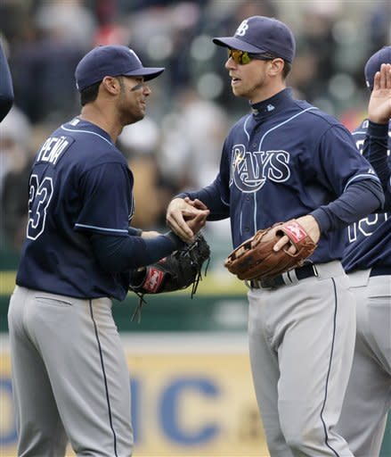Tampa Bay Rays' Carlos Pena, left, and Ben Zobrist celebrate their 4-2 win over the Detroit Tigers in a baseball game on Wednesday, April 11, 2012, in Detroit. Zobrist hit the game-winning single that drove in Pena in the ninth inning. (AP Photo/Duane Burleson)