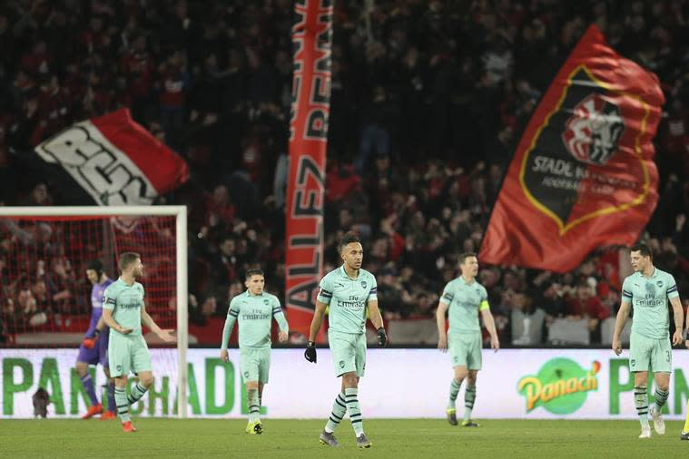 Arsenal players react after the second goal of Rennes during the Europa League round of 16, first leg soccer match between Rennes and Arsenal at Roazhon Park in Rennes, northwestern France