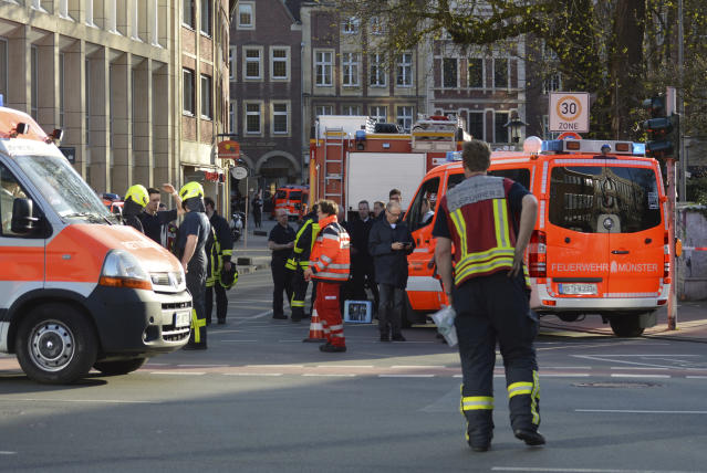 <p>Rescue workers stand outside the crime scene after a car crashed into a group of people leaving several dead in Muenster, Germany, Saturday, April 7, 2018. (Photo: Ferdinand Ostrop/AP) </p>