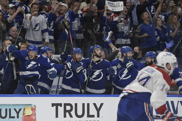 The Tampa Bay Lightning bench erupts after defeating the Montreal Canadiens to win the Stanley Cup in Game 5 of the NHL hockey finals, Wednesday, July 7, 2021, in Tampa, Fla. (AP Photo/Phelan Ebenhack)
