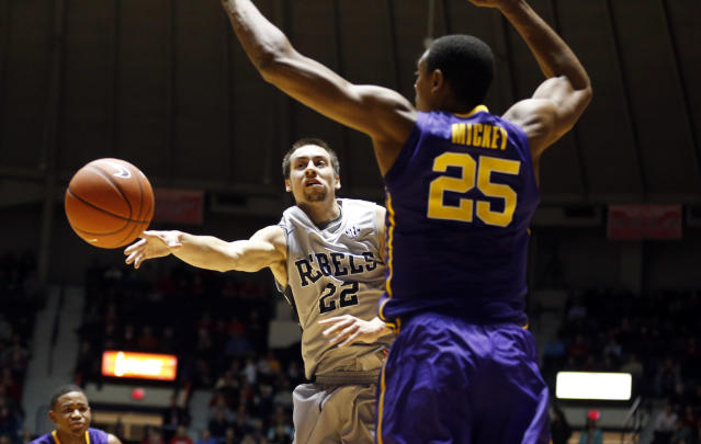 Mississippi guard Marshall Henderson (22) passes around the defense of LSU forward Jordan Mickey (25) in the first half of an NCAA college basketball game in Oxford, Miss., Wednesday, Jan. 15, 2014. (AP Photo/Rogelio V. Solis)
