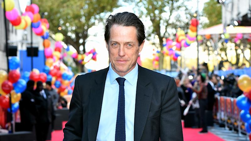 Hugh Grant smears marmalade on his face as he reprises Paddington 2 role