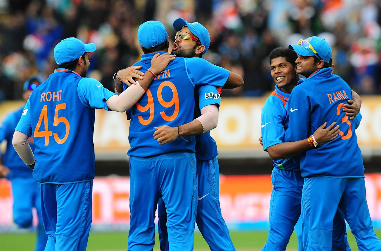 India players celebrate Alastair Cook wicket bowled , Umesh Yada (second right) caught Ravichandran Ashwin (99) for 2 during the ICC Champions Trophy Final at Edgbaston, Birmingham.