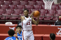 Alabama guard John Petty Jr. (23) grabs a rebound during the first half of the team's NCAA college basketball game against Kentucky, Tuesday, Jan. 26, 2021, in Tuscaloosa, Ala. (AP Photo/Vasha Hunt)