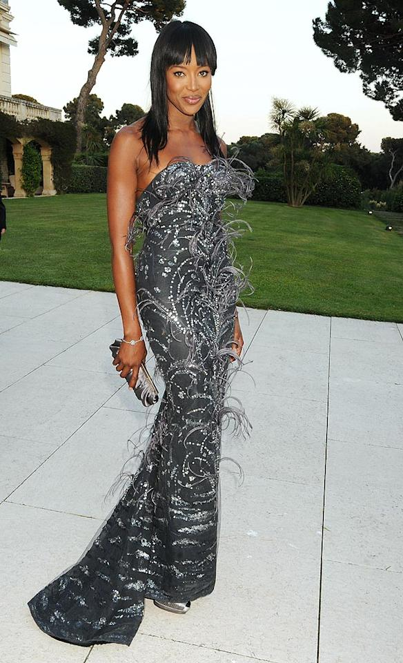 "Supermodel Naomi Campbell was simply stunning in her feathered, gunmetal gray L'Wren Scott Fall 2010 creation. Dave M. Benett/<a href=""http://www.gettyimages.com/"" target=""new"">GettyImages.com</a> - May 20, 2010"