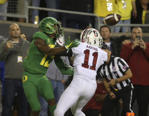 Oregon wide receiver Dillon Mitchell, left, and Stanford's Paulson Adebo compete in the end zone for a Justin Herbert pass in overtime of an NCAA college football game Saturday, Sept. 22, 2018, in Eugene, Ore. The pass was incomplete (AP Photo/Chris Pietsch)