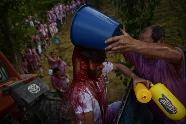 <p>A man has red wine thrown on him as he takes part in a wine battle, in the small village of Haro, northern Spain, Friday, June 29, 2018. (Photo: Alvaro Barrientos/AP) </p>