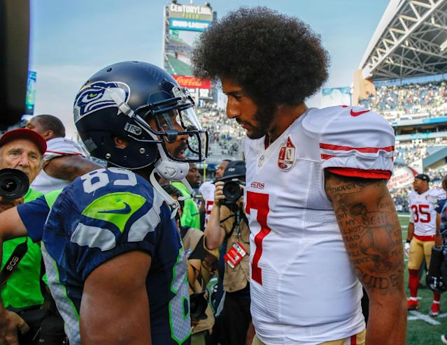 Colin Kaepernick, speaking with Seattle's Doug Baldwin in 2016, has filed a grievance against the NFL for allegedly blackballing him from the league. (Getty Images)