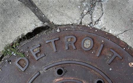 'Detroit' is seen on the top of an iron man-hole cover on a street in Detroit