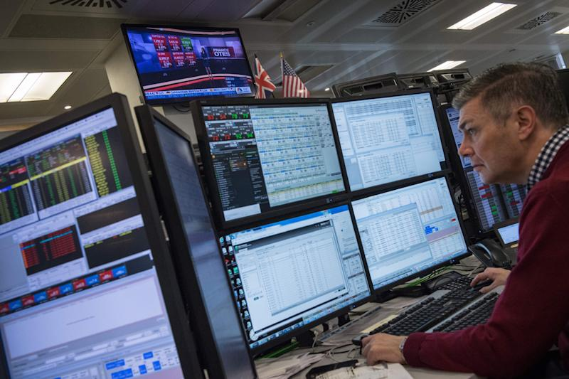 A television screen displays news footage relating to the result of France's presidential election, as traders works on the trading floor of ETX Capital in London on May 8, 2017. The Paris stock market rose slightly at the open Monday after the expected French presidential election win for Emmanuel Macron. Macron won a resounding victory in the French presidential election but the focus will shift immediately Monday to whether he can govern the country without the support of a traditional party. / AFP PHOTO / CHRIS J RATCLIFFE (Photo credit should read CHRIS J RATCLIFFE/AFP via Getty Images)