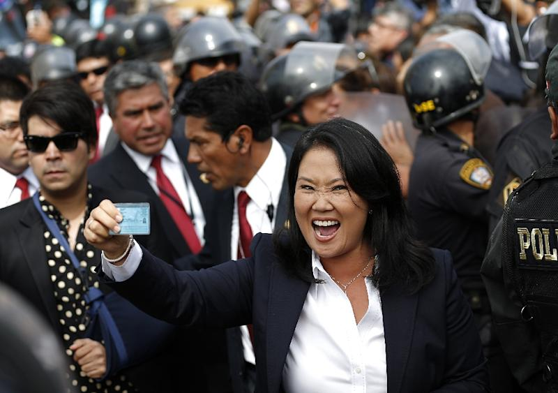 """Peru's presidential candidate Keiko Fujimori for """"Fuerza Popular"""" party, gestures after voting in the runoff round in Lima on June 5, 2016 (AFP Photo/Luka Gonzalez)"""
