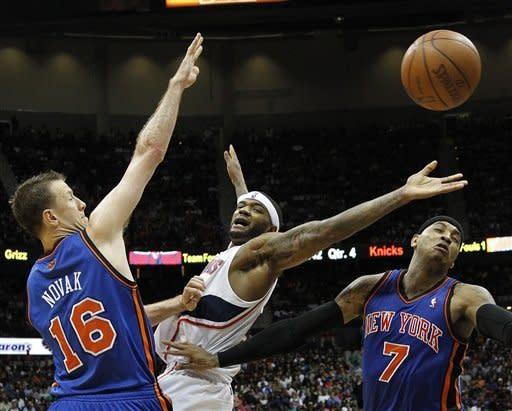 Atlanta Hawks forward Josh Smith, center, loses the ball as New York Knicks' Steve Novak (16) and Anthony (7) defend in the second half of an NBA basketball game in Atlanta, Friday, March 30, 2012. Atlanta won 100-90. (AP Photo/John Bazemore)
