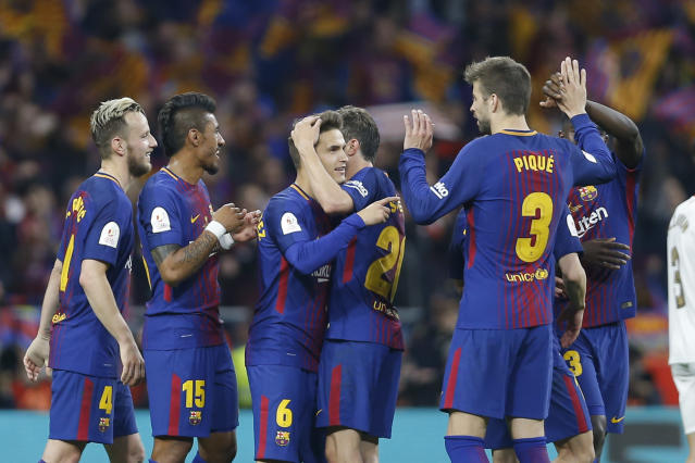 Barcelona's players celebrate after winning the Copa del Rey final soccer match between Barcelona and Sevilla at the Wanda Metropolitano stadium in Madrid, Spain, Saturday, April 21, 2018. (AP Photo/Francisco Seco)