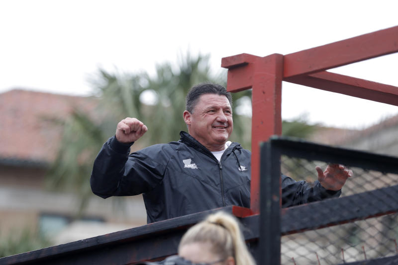 LSU head coach Ed Orgeron reacts to the crowd during a parade celebrating their NCAA college football championship, Saturday, Jan. 18, 2020, on the LSU campus in Baton Rouge, La. (AP Photo/Gerald Herbert)