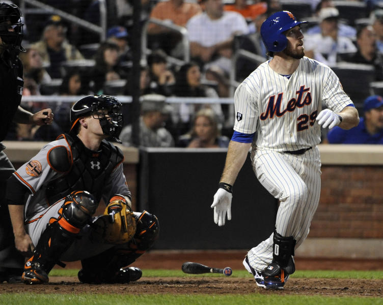 New York Mets' Ike Davis follows through on his grand slam as Baltimore Orioles catcher Matt Wieters, left, looks on during the sixth inning of an interleague baseball game, Monday, June 18, 2012, at Citi Field in New York. (AP Photo/Bill Kostroun)