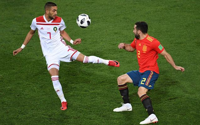"Get live updates from Iran vs Portugal in our other liveblog 7:19PM GOOOOOOOOOOOOOAAAAAAAAAAALLLLLL! ISCO SCORES FOR SPAIN! 7:19PM 19 mins - Spain 0 Morocco 1 Iniesta tries to make amends for his earlier error but hits an awful shot from 20 yards harmlessly wide and high. Out: Spain 0 - 1 Morocco (Andrés Iniesta, 18 min) Spain have woken up. There's zip to the passing and they're running aggressively into 50/50s. And all of a sudden they're in! 7:17PM 17 mins - Spain 0 Morocco 1 Is it harsh to suggest De Gea should have done better there? If he was in a Man Utd shirt I'd expect him to save that every single time but there's this unquantifiable vulnerability to him at international level. Morocco are just waiting to counter-attack over and again and Spain aren't enjoying themselves. They're full of confidence. 7:14PM GOOOOOOOOOOAAAAAAAAAAAALLLLLLL! MOROCCO TAKE THE LEAD! Spain 0 - 1 Morocco (Khalid Boutaïb, 14 min) Wow! That came out of nothing. It's a horrible error by Iniesta and Ramos at the halfway line and Boutaib has the entire half to run into! He sprints towards the box and only has De Gea to beat and you just knew he wasn't going to miss! The ball goes beneath De Gea's outstretched leg and Morocco go one up! 7:14PM 14 mins - Spain 0 Morocco 0 At first look that seems like a decent bit of defending by Hakimi but when you think about it, what he's done there is block the ball with his back and then deliberately batter into Silva to send him flying inside the box. It will never be penalty... but isn't it a foul? There is so much movement in the Spain midfield. Isco and Iniesta jave dropped back but THERE'S A MISTAKE! MOROCCO ARE AWAY! 7:12PM 12 mins - Spain 0 Morocco 0 Great run from Costa off the ball! He moves into space on the right channel and the ball is played there. Costa turns,m passes back and Silva breaks into the area. He's behind the last man, wide of the goal but nobody is in the area to take advantage of his cross. Warning signs that Spain are getting into this game. 7:09PM 10 mins - Spain 0 Morocco 0 Now. The thing here is that Pique has gone in way too aggressively here, it's off the ground, two-footed and could cause serious injury. But he gets the ball and doesn't really touch the striker at all... but he goes flying (of course) and makes out that he's hurt. He's not, and Pique has gotten away with it. This game is fiery. 7:08PM 8 mins - Spain 0 Morocco 0 It's all kicking off here! Amrabat is fired up and has had a little battle with Ramos after a collision from a 50/50. The two square up to each other... the fireworks are lit! The referee calms things down. For now. And now Pique has gone in mega hard on Boutaib! Morocco are going nuts. 7:06PM 6 mins - Spain 0 Morocco 0 Corner to Spain. David Silva will take this and the referee is already telling off defenders for holding Spanish players in the box. The corner is headed away and Busquets wins the ball with a tackle from behind, which the referee doesn't like. 7:04PM 4 mins - Spain 0 Morocco 0 Spain move up the pitch and Costa wins a free-kick from his evil alter ego, Da Costa. Spain pass around the opposition half, Carvajal gets forward but loses control and Morocco move it around... but there's a mistake! Isco overlaps... but his outside of the boot cross is too close to the goalkeeper. 7:02PM 2 mins - Spain 0 Morocco 0 Morocco have instantly gone into defensive mode and look like they're going to sit deep for most of this one. Morocco get the first bit of attacking done though and a cross from the left by Hakimi - who is a left-back wearing number two (disgraceful) - goes behind for a goal kick. 7:00PM KICK OFF BBC 4 works! We're in luck. But does that mean goals? We're about to find out! Spain get the game started. 6:57PM Really hope this works Tense wait on @BBCFOUR— Adam Hurrey (@FootballCliches) June 25, 2018 6:56PM National anthems When really, what they should play, is this: 6:48PM Diego Costa chasing the Golden Boot Race for the Golden Boot A hat-trick tonight would put him top of the scorers list. We might be getting ahead of ourselves a little here - Morocco are a decent team and are capable of an upset tonight. 6:29PM The BBC is lovely These adverts, enthusiastically hosted by Spain's top presenters, are a regular feature on Spanish TV's World Cup coverage... #RinconCulturalpic.twitter.com/8VayrPtYfK— The Spanish Football Podcast (@tsf_podcast) June 25, 2018 6:20PM A nice wee stat 8 - Spain have won their final group game in each of the last eight World Cup tournaments; a run stretching back to 1986. Sealed. #ESPMAR#ESP#WorldCuppic.twitter.com/cc2QhKJS98— OptaJoe (@OptaJoe) June 25, 2018 6:17PM Where is the game? World Cup 2018 stadium: Kaliningrad Stadium 6:10PM Spain need one point to progress But with Portugal likely to get a victory over Iran, there's just no way they'll settle for a point. The interesting thing about this game will be how Morocco deal with it - do they suddenly turn on the magic now there's no pressure? Or will they have a lack of real motivation and fall victim to Spain's sharp passing? 6:02PM But who will win? World Cup 2018 Simulator Single Game 5:57PM Total Football podcast While you're getting all revved up for this game, why not give our podcast a listen? Jamie Carragher is on it. 5:53PM Starting lineups Spain De Gea; Carvajal, Pique, Ramos, Alba; Busquets, Thiago, Iniesta; Silva, Isco, Costa �� OFICIAL | ¡Ya tenemos ONCE de España! Estos son los elegidos por Fernando Hierro para buscar la victoria y el primer puesto del grupo. ¡VAMOS, ESPAÑA!#HagamosQueOcurra#Rusia2018pic.twitter.com/Jv23vn7DcM— Selección Española de Fútbol (@SeFutbol) June 25, 2018 Morocco El Kajoui; Hakimi, Da Costa, Saidd, Ziyach, El Ahmadi, Belhanda, Boutaib, Boussouga, Amrabat, Dirar 5:49PM How will Spain play? I can tell you, through the medium of VIDEO! 5:30PM Good evening! Welcome to our liveblog for Spain's final group game. Tonight they're going to try and put as many goals as possible past Morocco in the hope that goal difference will give them a better/easier opponent in the knock-out rounds of the World Cup, even if Fernando Hierro has been keen to stress that mathematically they still aren't through yet. The brand new Spain manager has also pointed out that his side have a certain way of playing, and won't adjust for their opponents: ""If we had to change for muscle, we're something else, more than muscle. Honestly, we have our own way of playing, our own physique and muscle isn't going to work for us. ""We are a team. We like to attack and defend together and this is to stop our rivals from making transitions and stop them creating chances against us. For this reason we know we need to think about what we believe in and not about what the opposition coach is planning to do. ""Isco always brings quality, effort, one-on-ones, is combative and gets in between the lines. It's difficult for him to maintain a fixed position and he's performing very well, just like his teammates. He's performed at this elite level for a while now and we know what he can bring to the team."" Spain World Cup tactics article Morocco are definitely out of the World Cup and may well opt to field some of the players who haven't yet made an appearance. They may also go with their strongest XI to avoid being given a hiding but it is expected that Spain should win this meeting comfortably, with the only question being how many goals will separate the two teams at the final whistle. Team news should be with us very soon, at which point we can work out how both sides plan to approach the match and what is likely to happen during it! Stay with us for live analysis and updates throughout."