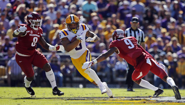 "LSU running back <a class=""link rapid-noclick-resp"" href=""/ncaaf/players/250978/"" data-ylk=""slk:Derrius Guice"">Derrius Guice</a> (5)carries between Arkansas linebacker De'Jon Harris (8) and defensive back Santos Ramirez (9) in the first half of an NCAA college football game in Baton Rouge, La., Saturday, Nov. 11, 2017. (AP Photo/Gerald Herbert)"
