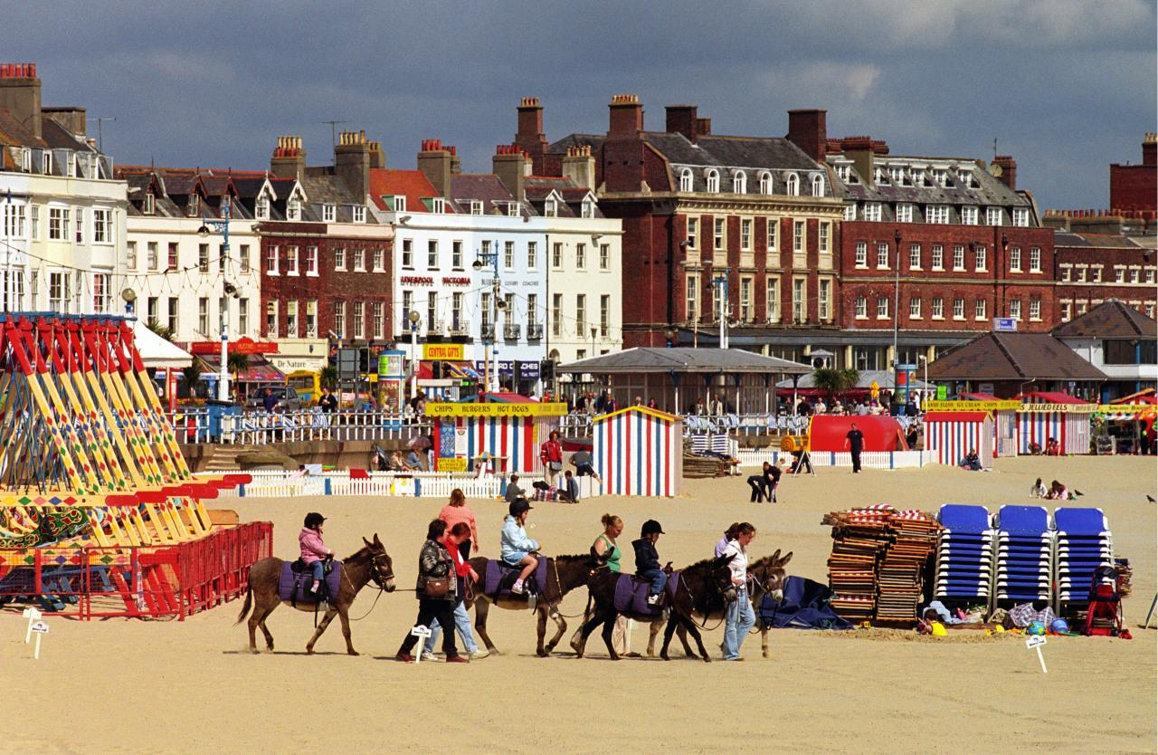 <p>Backed by a pretty Victorian promenade and home to donkeys and brightly coloured fairground rides, Dorset's Weymouth Beach still has that touch of old-school seaside charm. (Rex)</p>