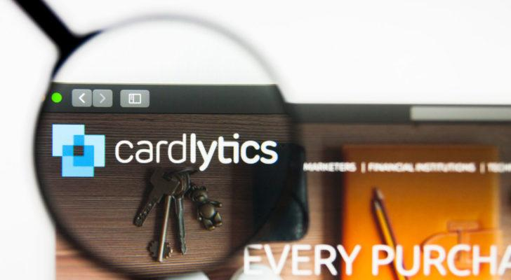a magnifying glass zooms in on the Cardlytics logo on the company website