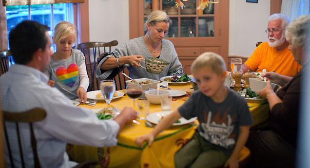 North Andover, MA - 10/11/2012 - MIDDLE CLASS PROJECT - Ann and Barry Low (far right), their daughter, Jessica Wood (center) and son-in-law, Randy Wood (far left) and their grandchildren, Maisie and Emmett Wood, cq, sit down together for their nightly evening meal on Thursday evening, October 11, 2012. They all live in the same household since the Woods moved back in to save money and send Randy back to school. ----- This is a story about the changing and increasing struggles of the middle class through the lens of one family -- the Lows. The Lows - Anne and Barry - are retired teachers who live in North Andover. They have three daughters, one of whom, Jessica, recently moved back home with her husband and children while he pursues a teaching certificate for a career they think will be more secure than his current one as a bar manager. Story by Sarah Schweitzer/Globe Staff. Dina Rudick/Globe Staff