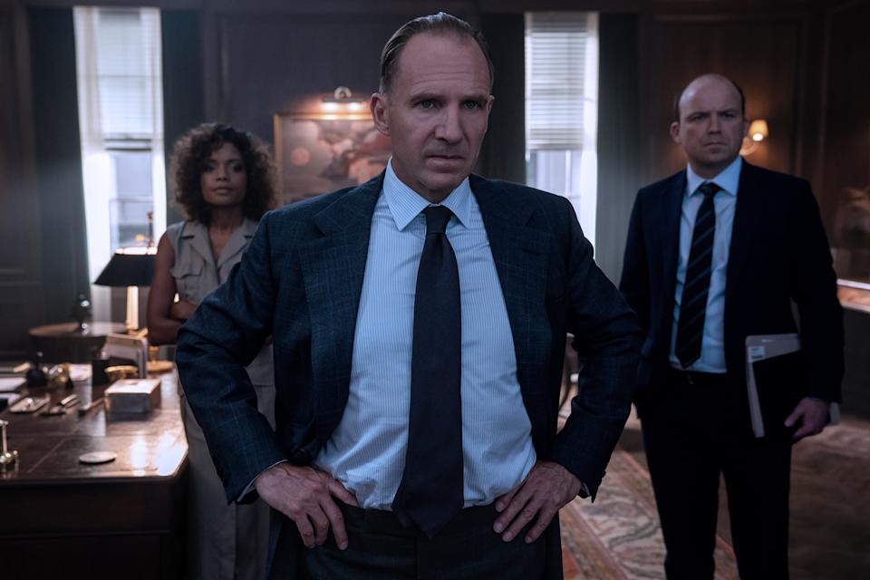 M (Ralph Fiennes), Moneypenny (Naomie Harris) and Tanner (Rory Kinnear) in a tense moment in M's office in  NO TIME TO DIE, a DANJAQ and Metro Goldwyn Mayer Pictures film. (Credit: Nicola Dove. © 2019 DANJAQ, LLC AND MGM.  ALL RIGHTS RESERVED.)