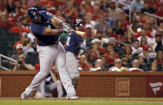 Milwaukee Brewers' Jesus Aguilar hits a two-run single during the eighth inning of a baseball game against the St. Louis Cardinals on Friday, Aug. 17, 2018, in St. Louis. (AP Photo/Jeff Roberson)