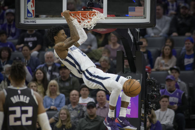 Grizzlies guard Ja Morant (12) throws one down against the Kings on Jan. 2. (AP Photo/Randall Benton)