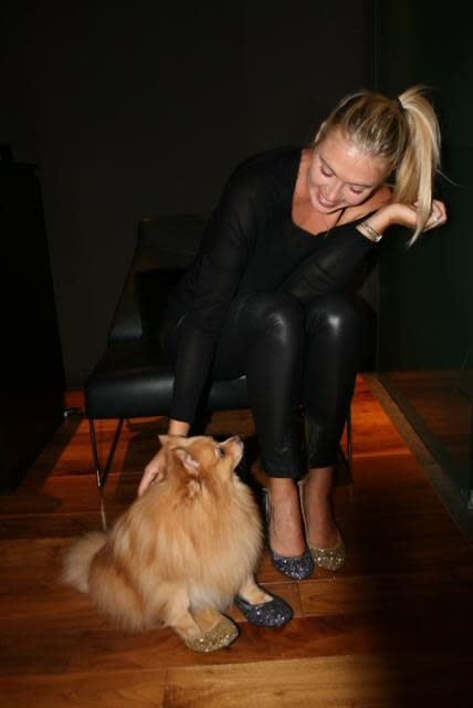 Maria Sharapova and her pomeranian, Dolce, trying on Cole Haan flats.