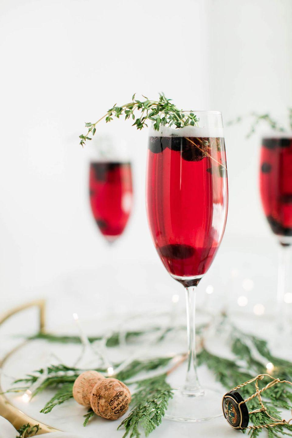 """<p>Blueberries lend these gorgeous cocktails their lovely deep hue, as well as some flavor.</p><p><strong>Get the recipe at <a href=""""https://thesweetestoccasion.com/2018/12/blueberry-sparkler-champagne-cocktail/"""" rel=""""nofollow noopener"""" target=""""_blank"""" data-ylk=""""slk:The Sweetest Occasion"""" class=""""link rapid-noclick-resp"""">The Sweetest Occasion</a>.</strong></p><p><strong><a class=""""link rapid-noclick-resp"""" href=""""https://www.amazon.com/Lenox-845276-Tuscany-Classics-Champagne/dp/B00FYH8V6O/ref=sr_1_1_sspa?tag=syn-yahoo-20&ascsubtag=%5Bartid%7C10050.g.30433150%5Bsrc%7Cyahoo-us"""" rel=""""nofollow noopener"""" target=""""_blank"""" data-ylk=""""slk:SHOP CHAMPAGNE FLUTES"""">SHOP CHAMPAGNE FLUTES</a><br></strong></p>"""