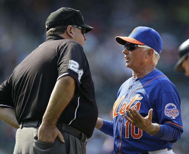 New York Mets manger Terry Collins, right, argues with umpire Jerry Layne over a call during the tenth inning of the baseball game against the Atlanta Braves at Citi Field, Wednesday, Aug. 21, 2013, in New York. Collins was later ejected and the Braves won 4-1. (AP Photo/Seth Wenig)