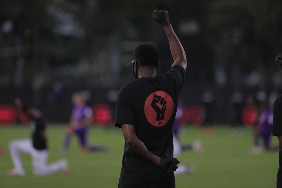 The Black Players for Change assembled on the field July 8, 2020 at the ESPN Wide World of Sports Complex ahead of the first match at the MLS Is Back Tournament.